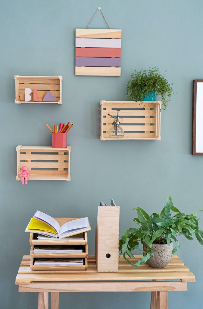 Wooden box shelves with decorations on the wall, natural decor concept.